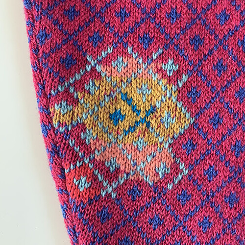 Swiss darned elbow on a wool cardigan. Visible mending by Collingwood-Norris
